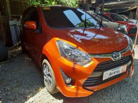 Sell Orange 2019 Toyota Wigo in Quezon City