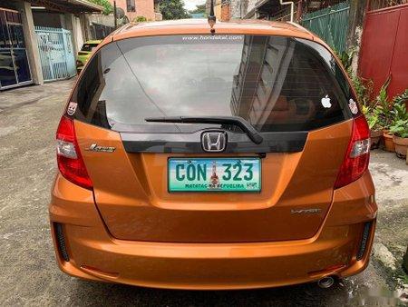 Selling Orange Honda Jazz 2013 Hatchback Automatic Gasoline
