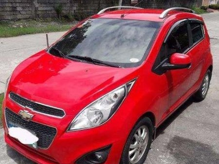 Red 2013 Chevrolet Spark at 65000 km for sale in Pampanga