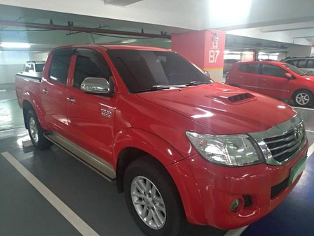 Red 2013 Toyota Hilux at 54000 km for sale in Quezon City