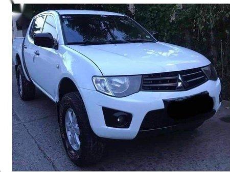 Sell White 2012 Mitsubishi Strada in Concepcion