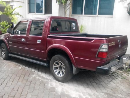 Red Isuzu Fuego 2003 for sale in San Juan