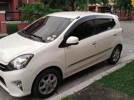Pearlwhite Toyota Wigo 2014 for sale in Malolos