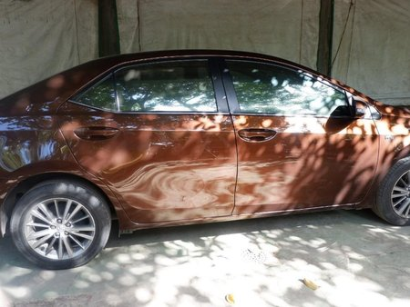 Sell Brown 2014 Toyota Corolla altis in Carmona