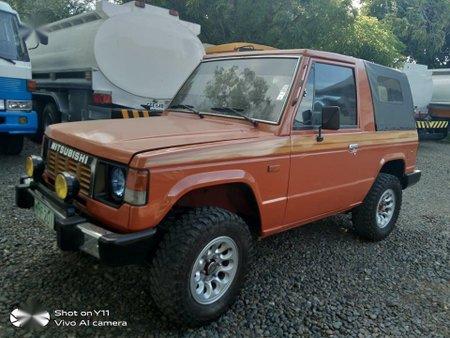 Selling Orange Mitsubishi Pajero for sale in Bustos