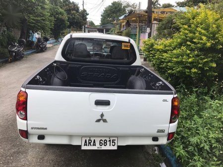 Sell Pearl White 2014 Mitsubishi Strada in Manila