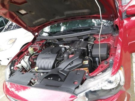 Red Mitsubishi Lancer 2013 for sale in Quezon City