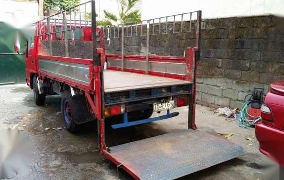 Isuzu Elf Dropside stainless with POWER LIFTER 10 ft. Single tire GIGA