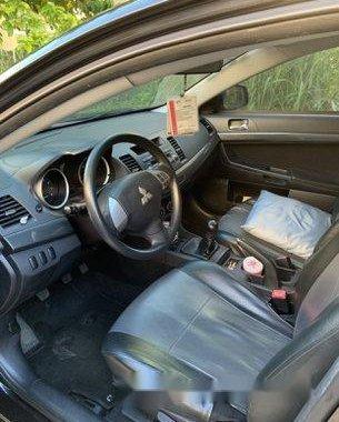 Selling Black Mitsubishi Lancer Ex 2012 Manual Gasoline at 80000 km