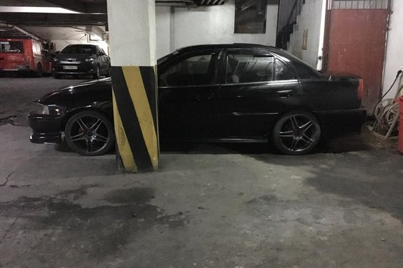 Selling Black Mitsubishi Lancer 2001 Automatic in Manila
