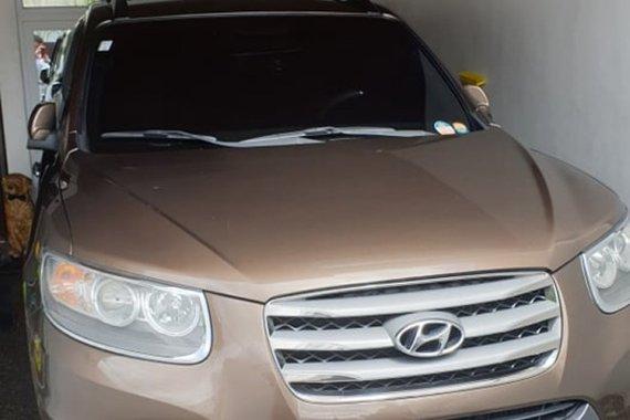 Brown Hyundai Santa Fe 2012 for sale in Quezon City