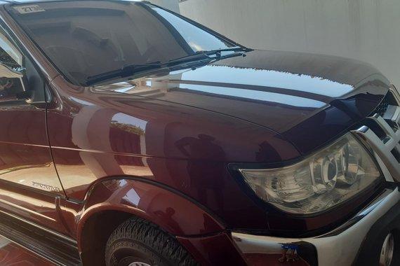 Dark Red Isuzu Sportivo 2012 at good price for sale in Tagum City