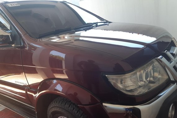 Dark Red Isuzu Sportivo 2012 at good price for sale in Tagum City