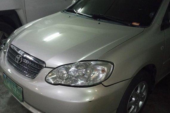Selling Silver Toyota Corolla Altis 2004