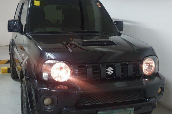 Selling used 2013 Suzuki Jimny JLX AT (Monotone) in Black