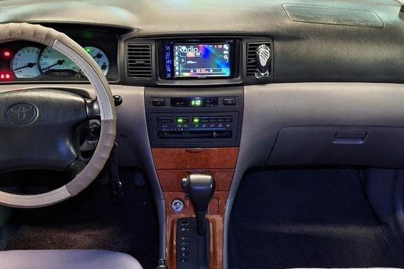 Selling Brightsilver Toyota Corolla Altis 2002 in Pateros