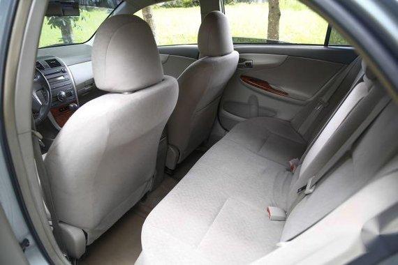 Brightsilver Toyota Corolla Altis 2010 for sale in Quezon