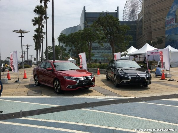 two Mitsubishi Grand Lancer in red and black