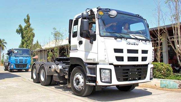 two Isuzu Trucks on the road