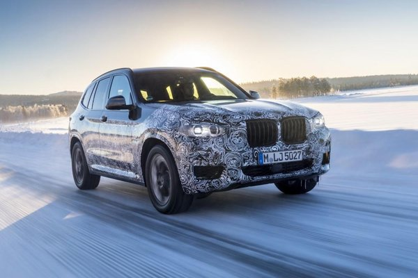 BMW X3 M40i running on a road
